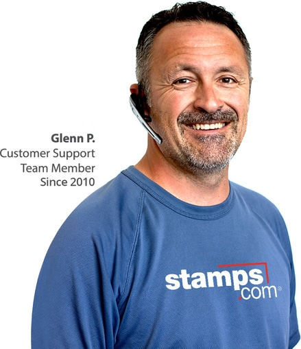 A photograph of a customer support rep smiling and wearing a Stamps.com t-shirt