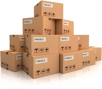 A bundle of packages labeled fragile stacked on top of each other almost in the shape of a pyramid.