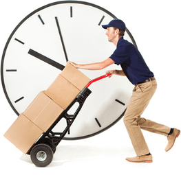 A delivery man moving packages on a dolly with a clock in the background.